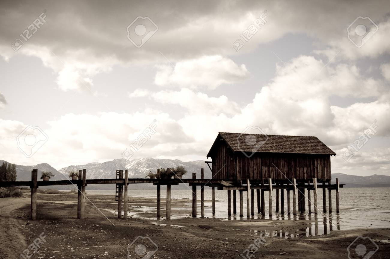Landscape of wooden jetty extending out, dramatic clouds and mountains in background Stock Photo - 4007229