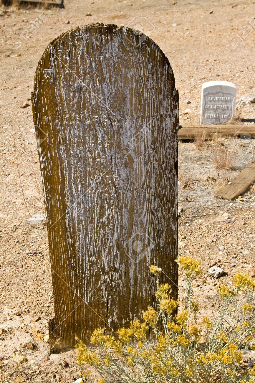 Old Weathered Wooden Grave Marker In Desolate Landscape