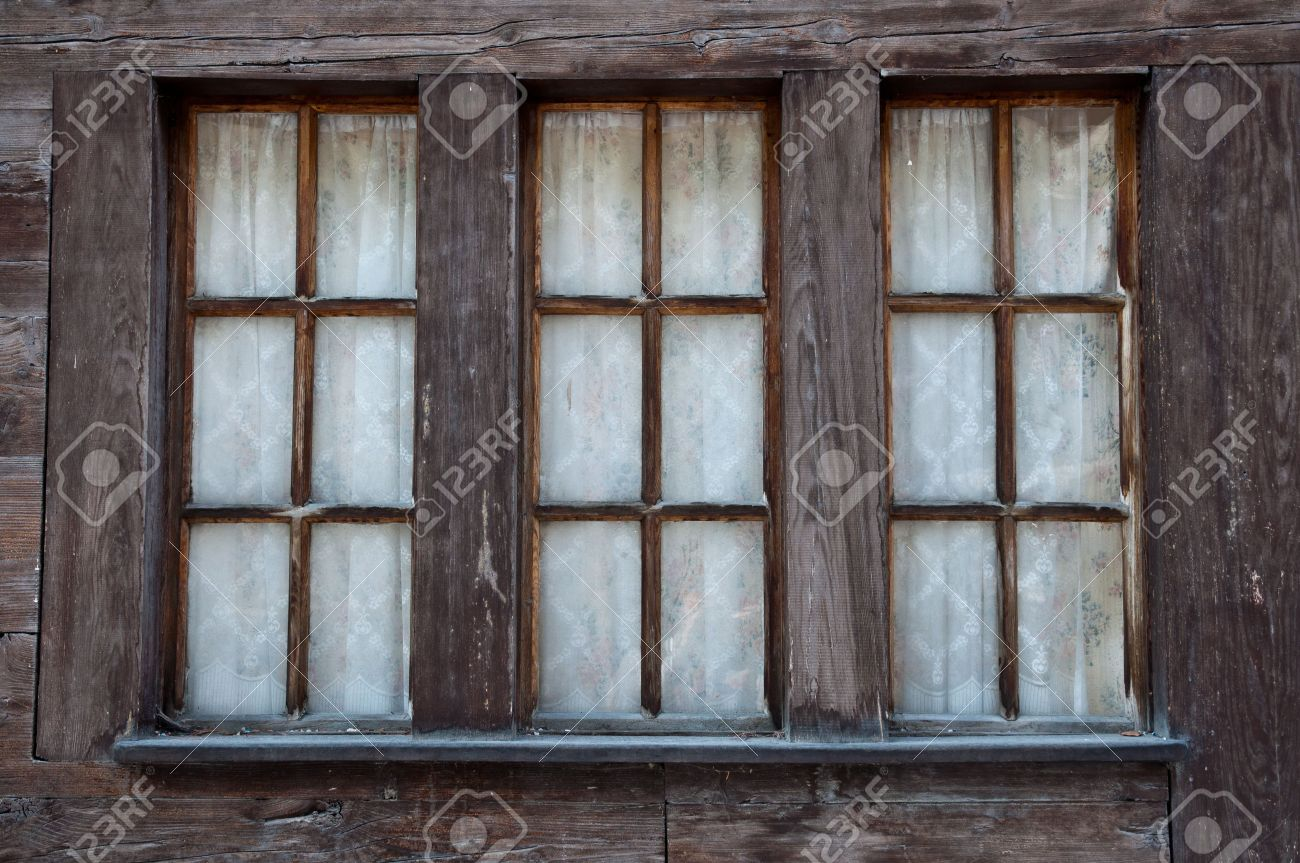 Old Windows In Wooden Frame From A Traditional Swiss Chalet Stock