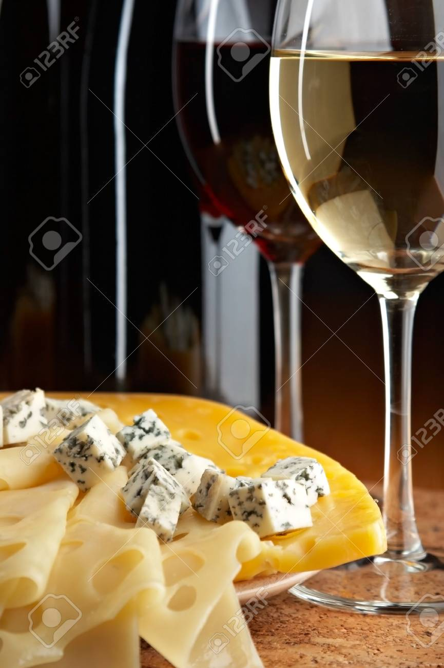 still life with cheese and wine on the black background Stock Photo - 2822779