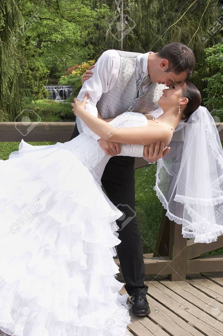 bridegroom and beautiful bride in white on the wedding in park Stock Photo - 3238566