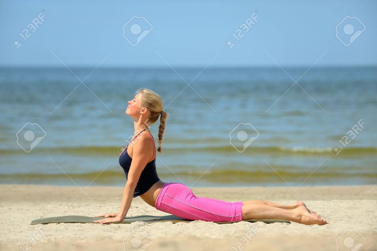 Beautiful blond female workout on the beach Stock Photo - 4249717
