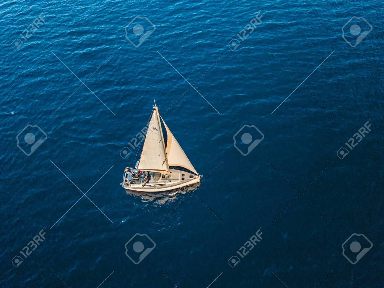 Turkey, Mediterranean sea - 27.10.2019: Fly around the yacht in open sea - 141904782