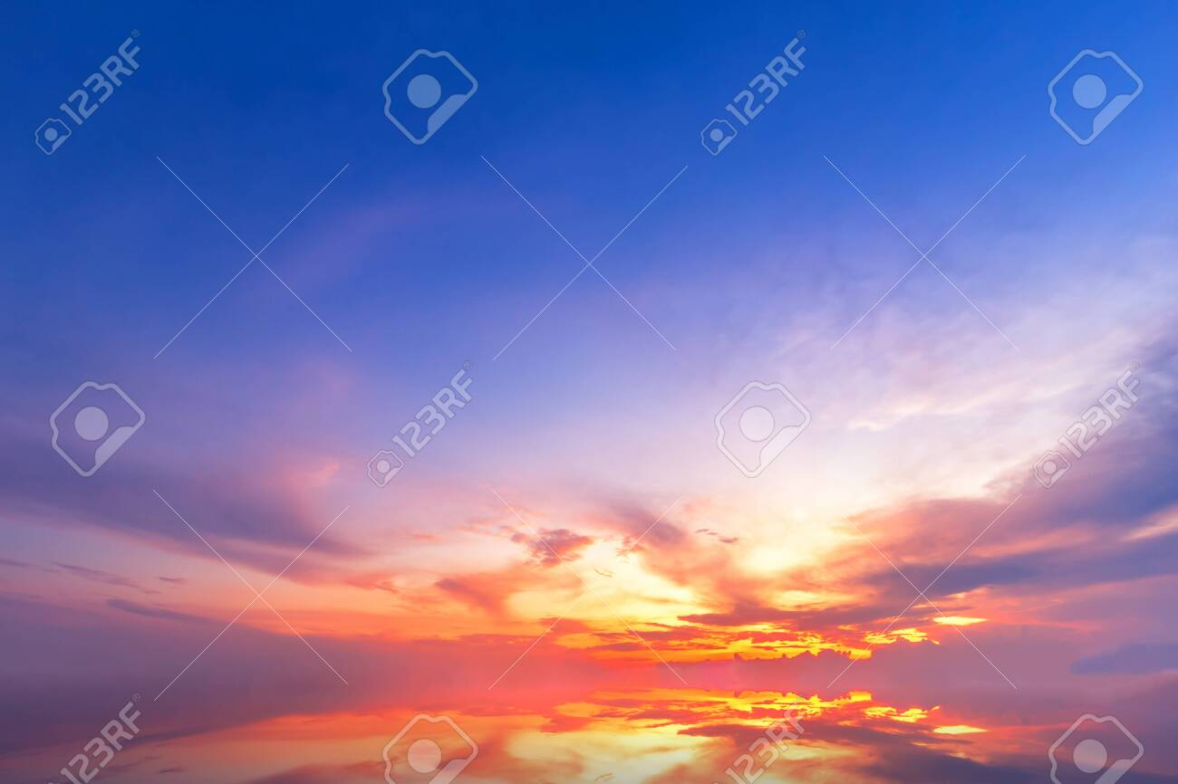Beautiful fluffy clouds with evening sunset background. - 131278929