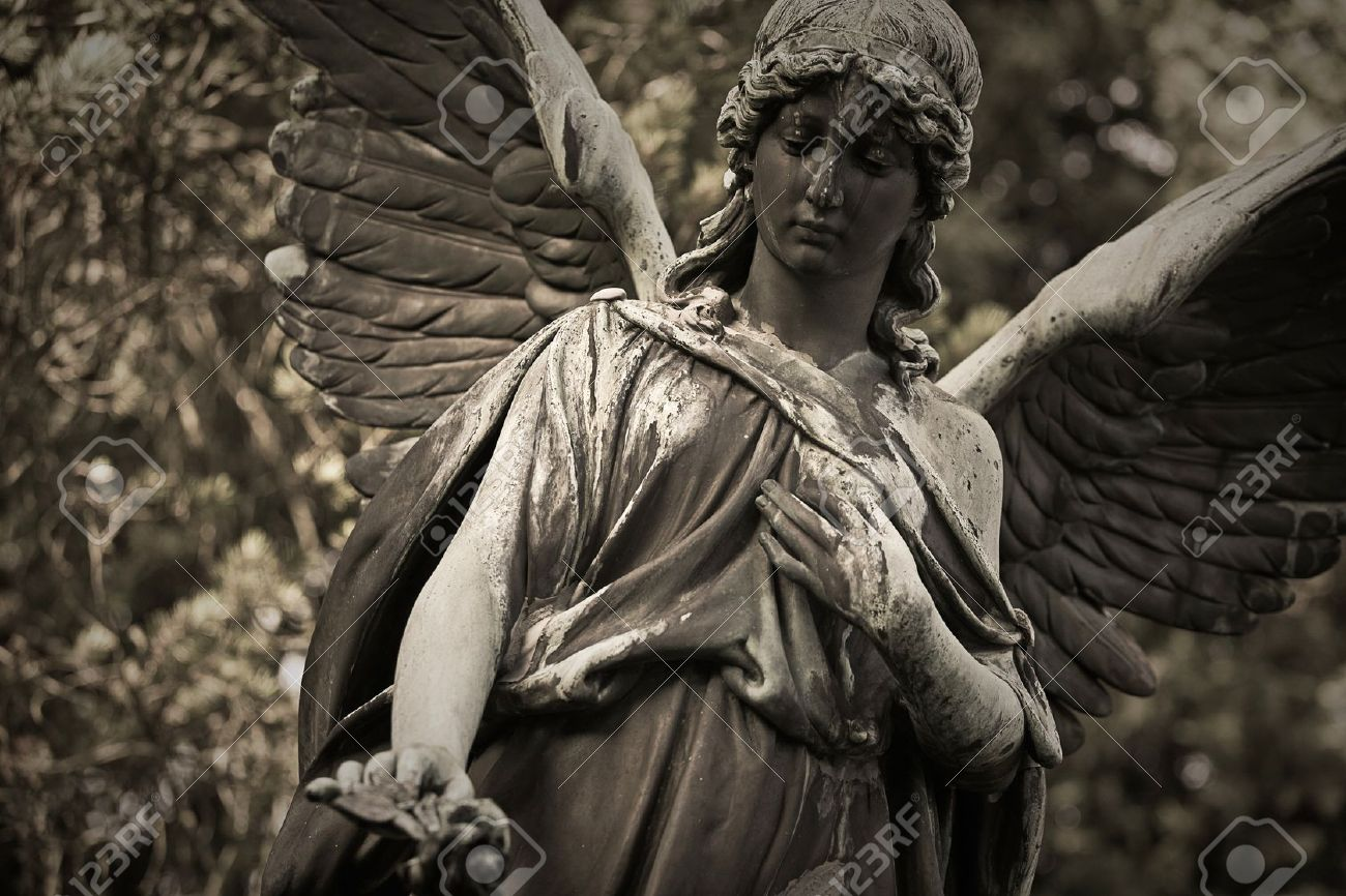 Angel statue in an old cemetery - 12084028