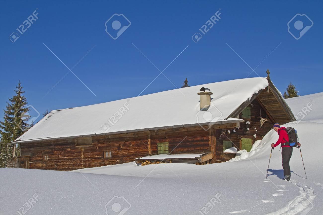 Ski tourers before idyllic pasture in Upper Bavaria Stock Photo - 14128668