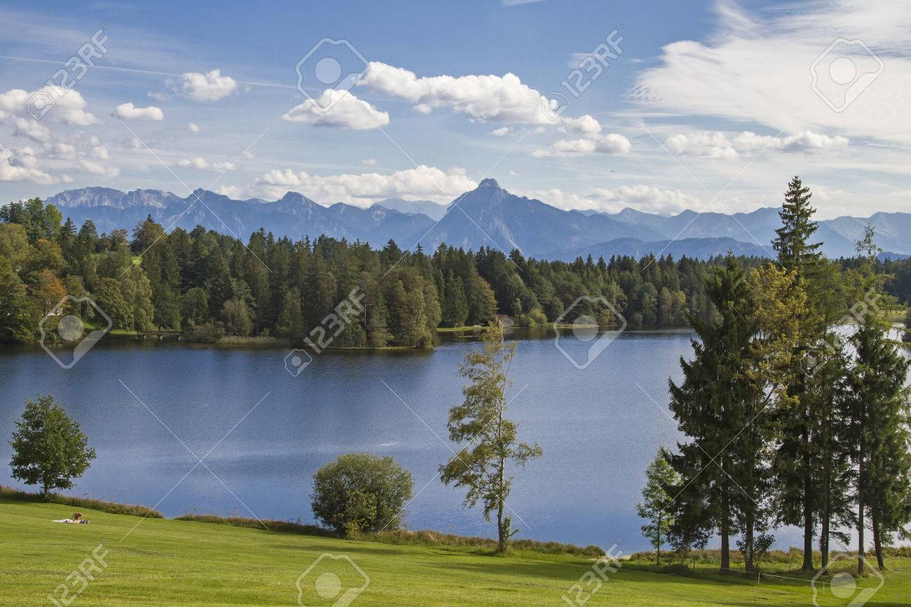 The Schwalten pond in allgaeu is an idyllic lake which is used today as a bathing lake and fish farming - 33276704