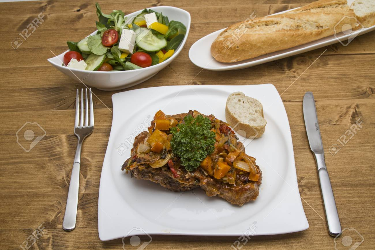 Ossobuco alla milanese is a traditional stew from Italy - 33486241