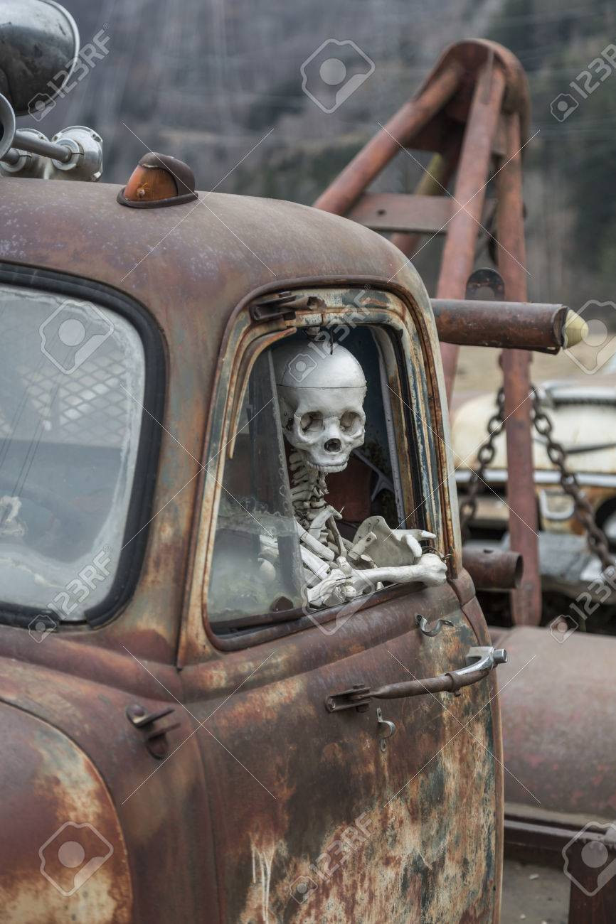 Death Travels With - Skeleton At The Wheel Of An Old Junk Cars Stock ...