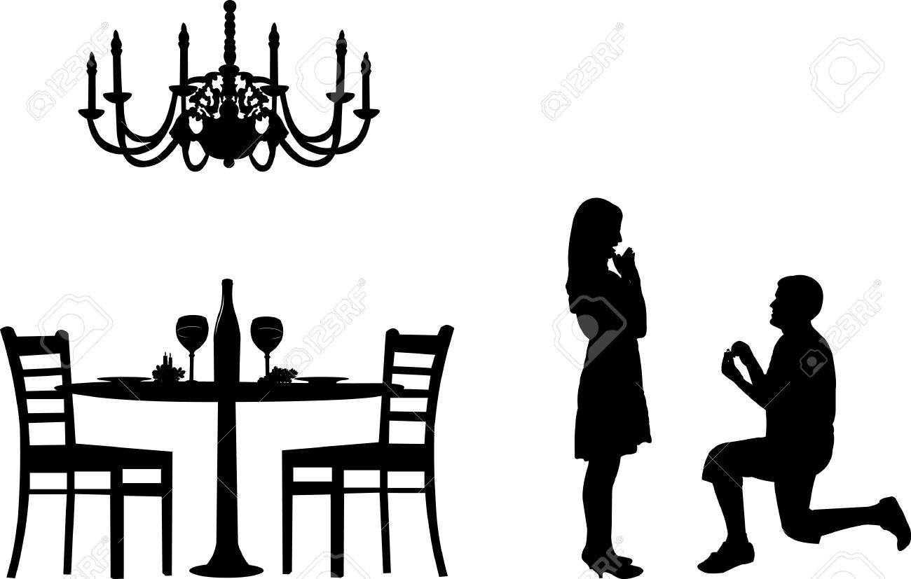 Romantic proposal in a restaurant on Valentine's day of a man proposing to a woman while standing on one knee silhouettes, one in the series of similar images - 12431583