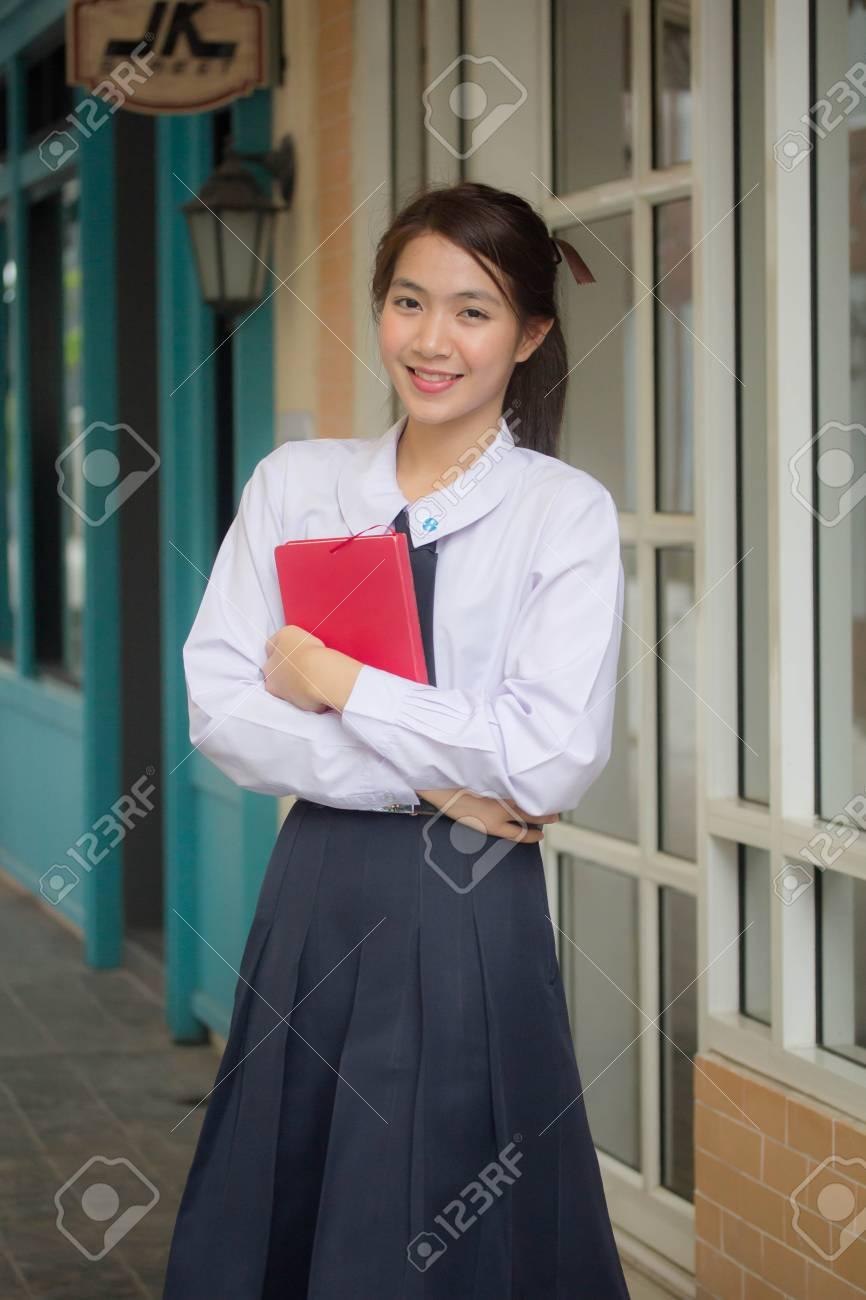 378cc337b Portrait of thai high school student uniform teen beautiful girl happy and  relax Stock Photo -