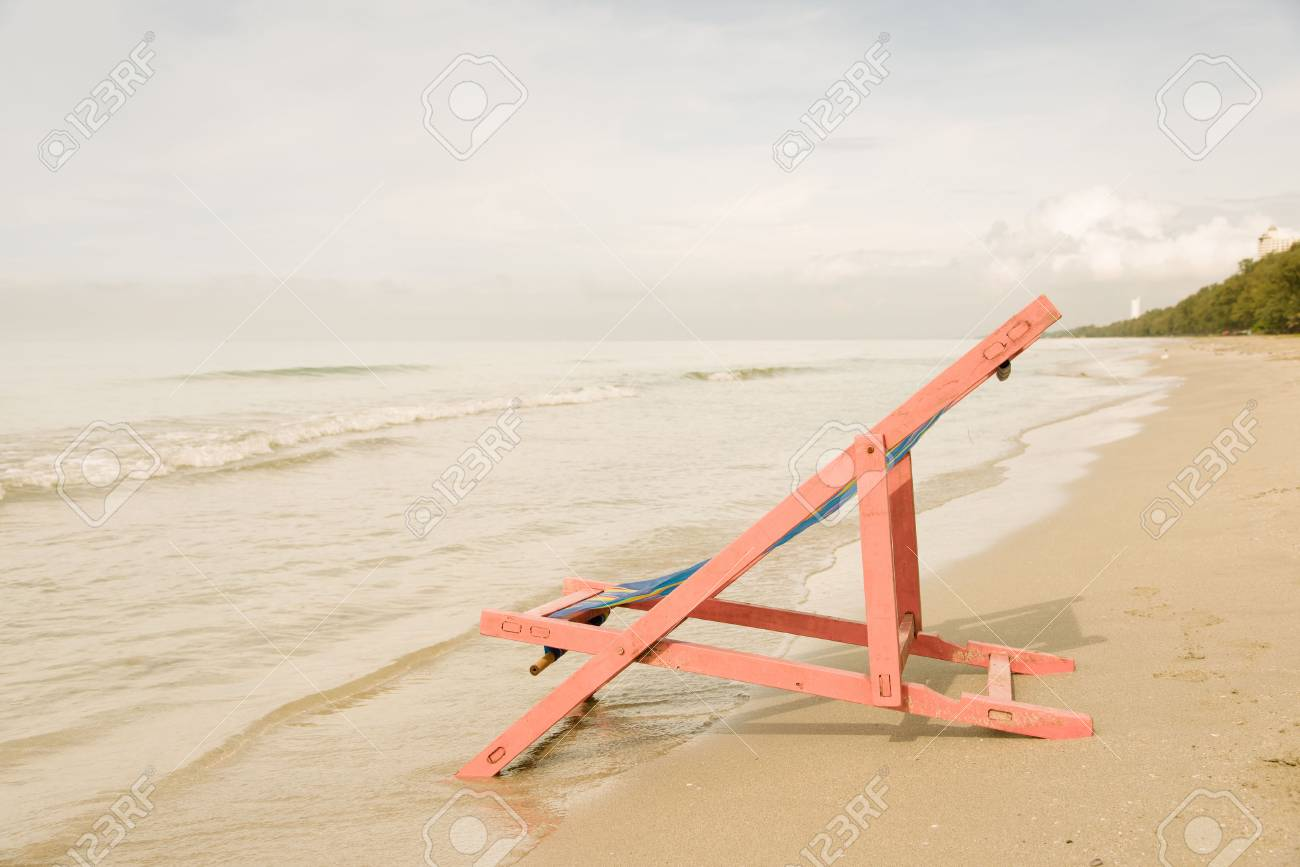 Vintage Warm Tone Pink Beach Chair At The Close Of The Sea Water Stock Photo Picture And Royalty Free Image Image 52947743