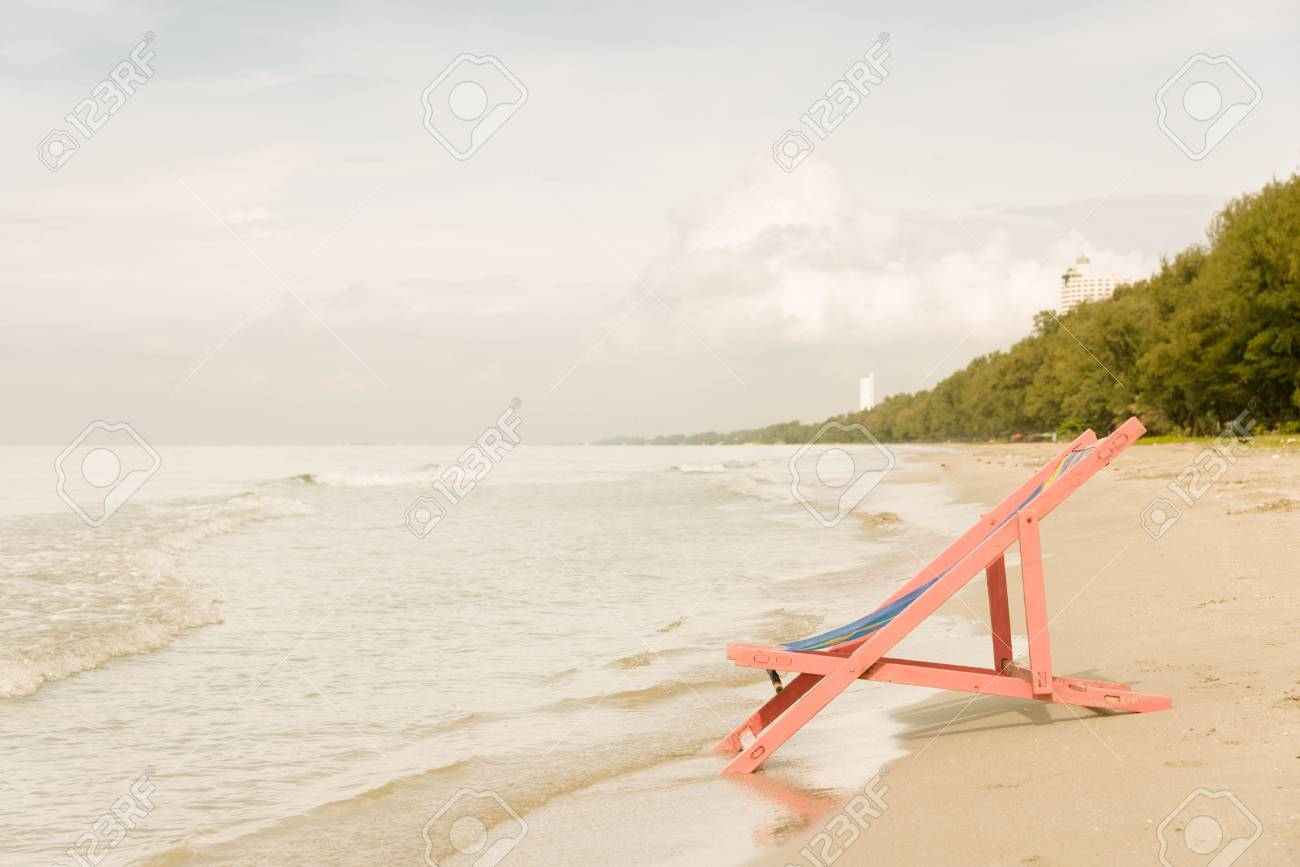Vintage Warm Tone Pink Beach Chair At The Close Of The Sea Water Stock Photo Picture And Royalty Free Image Image 60740344