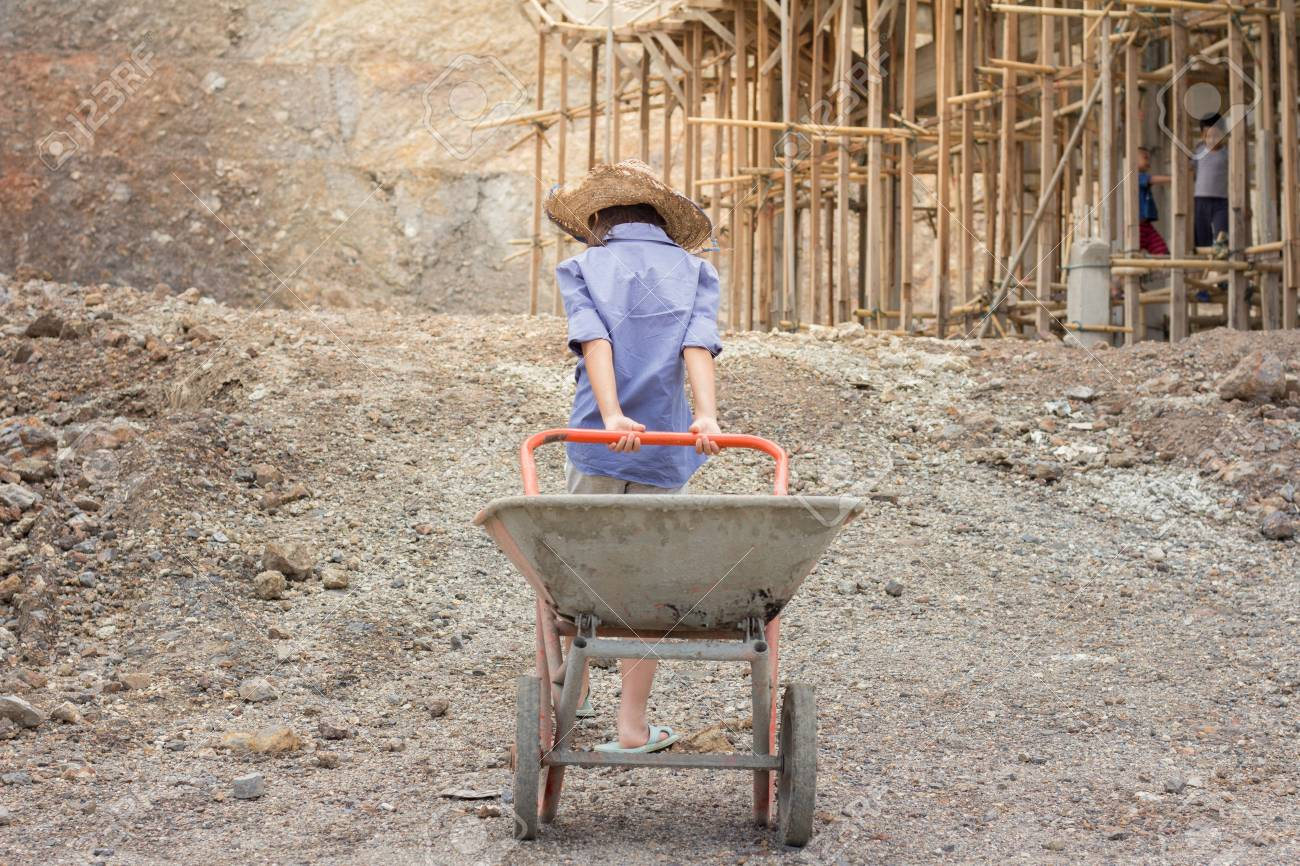 Poor children working at construction site against children labour, World Day Against Child Labour and trafficking concept. - 108952985