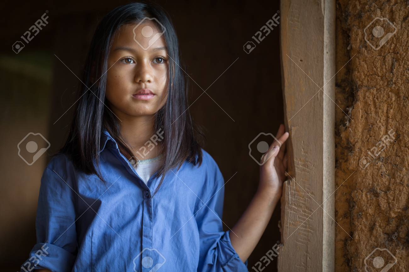 Portrait of a poor little thailand girl lost in deep thoughts, poverty, Poor children, War refugees - 112182420