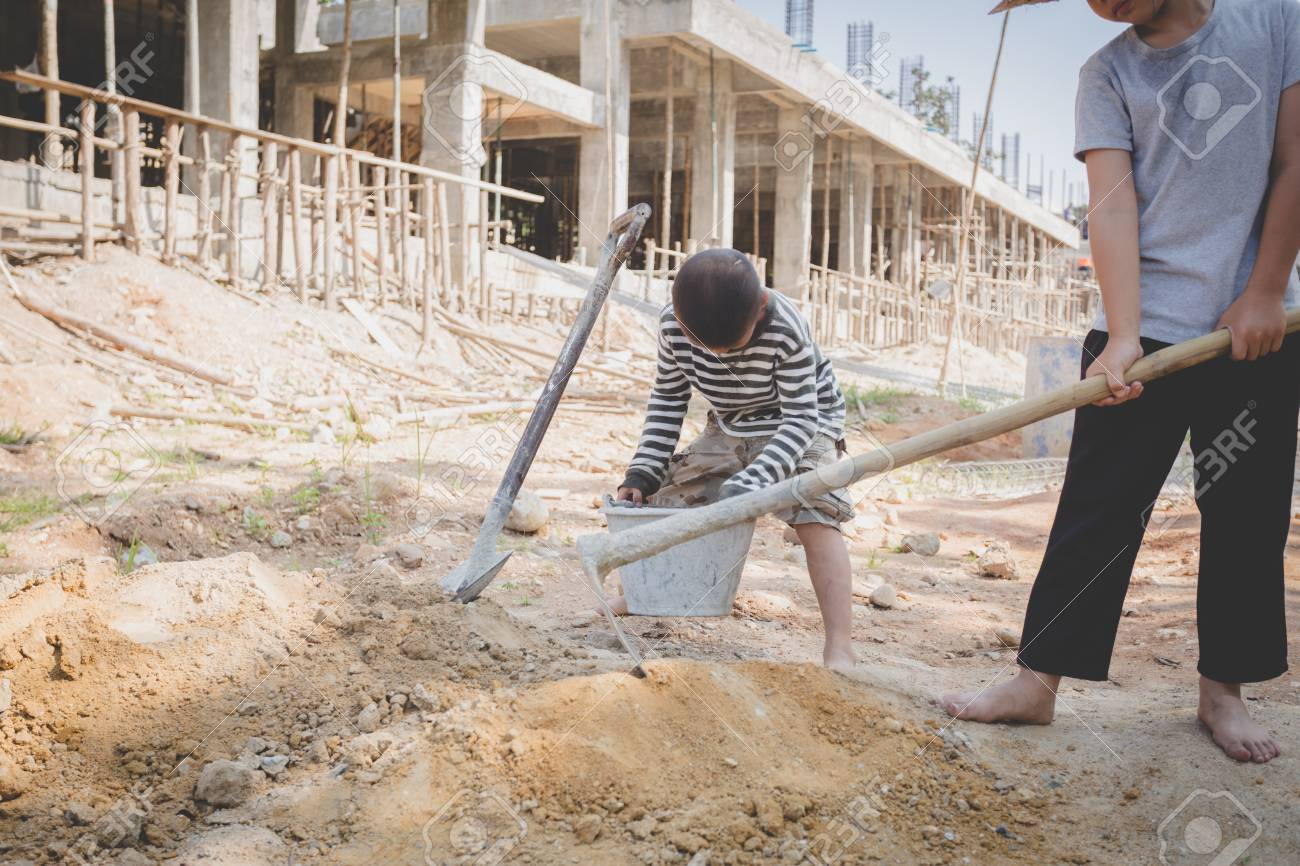 boys labor work in the construction site, Against child labor, Poor children, construction work, Violence children and trafficking concept - 112440539