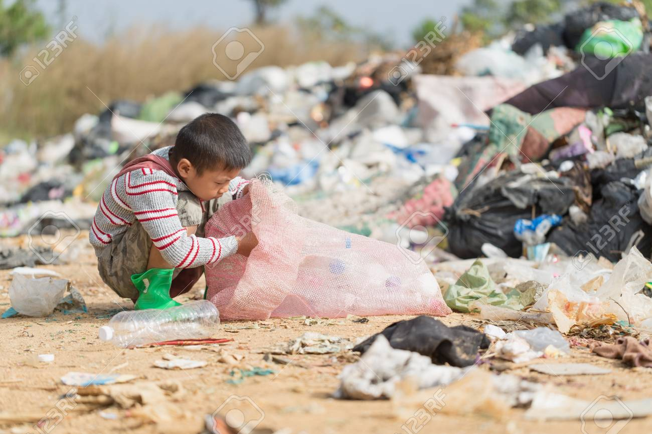 Poor children collect garbage for sale because of poverty, Junk recycle, Child labor, Poverty concept, World Environment Day, - 114538038