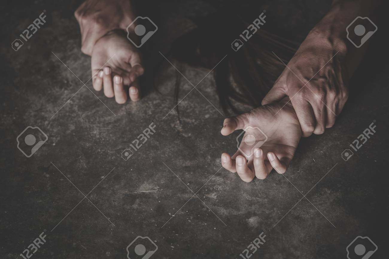 Man's hand holding a woman hand for rape and abuse concept, Wound domestic violence rape, concept photo of assault, International Women's Day - 121176599