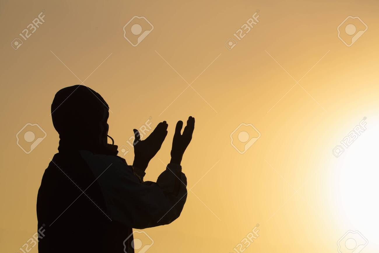 Man praying at sunset mountains raised hands Travel Lifestyle spiritual relaxation emotional concept, Freedom and travel adventure. - 126112653