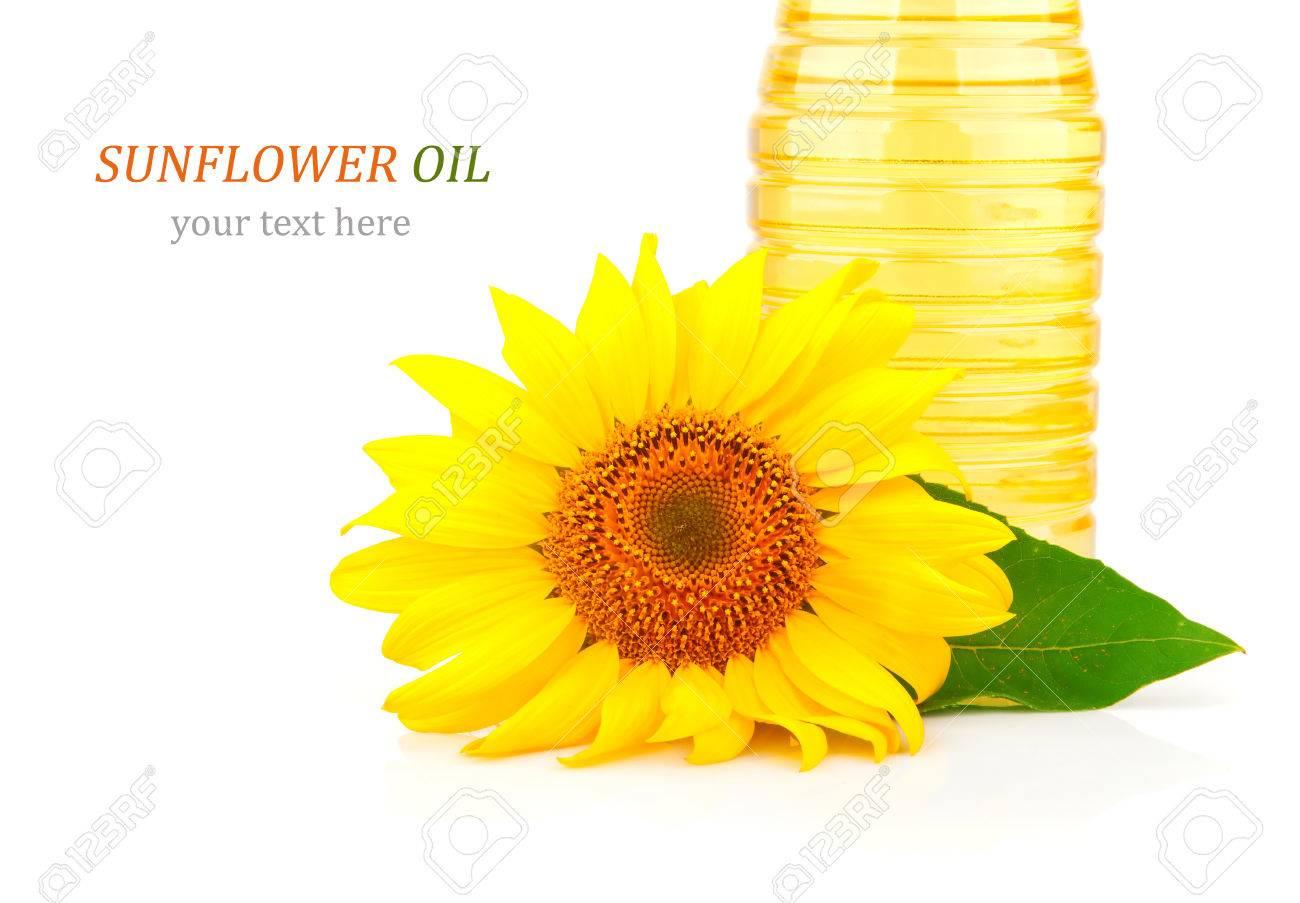 l'huile de tournesol dans des bouteilles en plastique et fleur