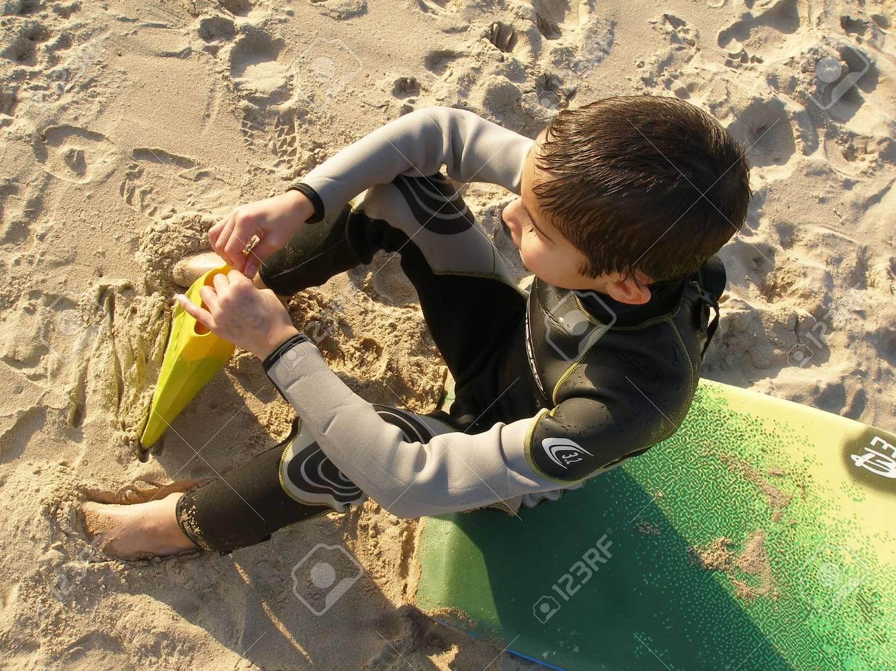 a boy sitting on his bodyboard board Stock Photo - 404206