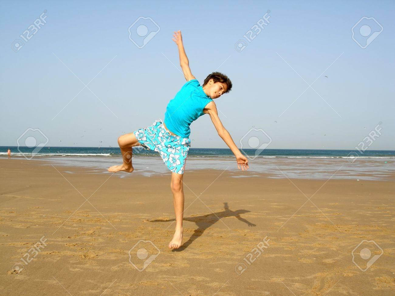 boy jumping on the beach Stock Photo - 434852
