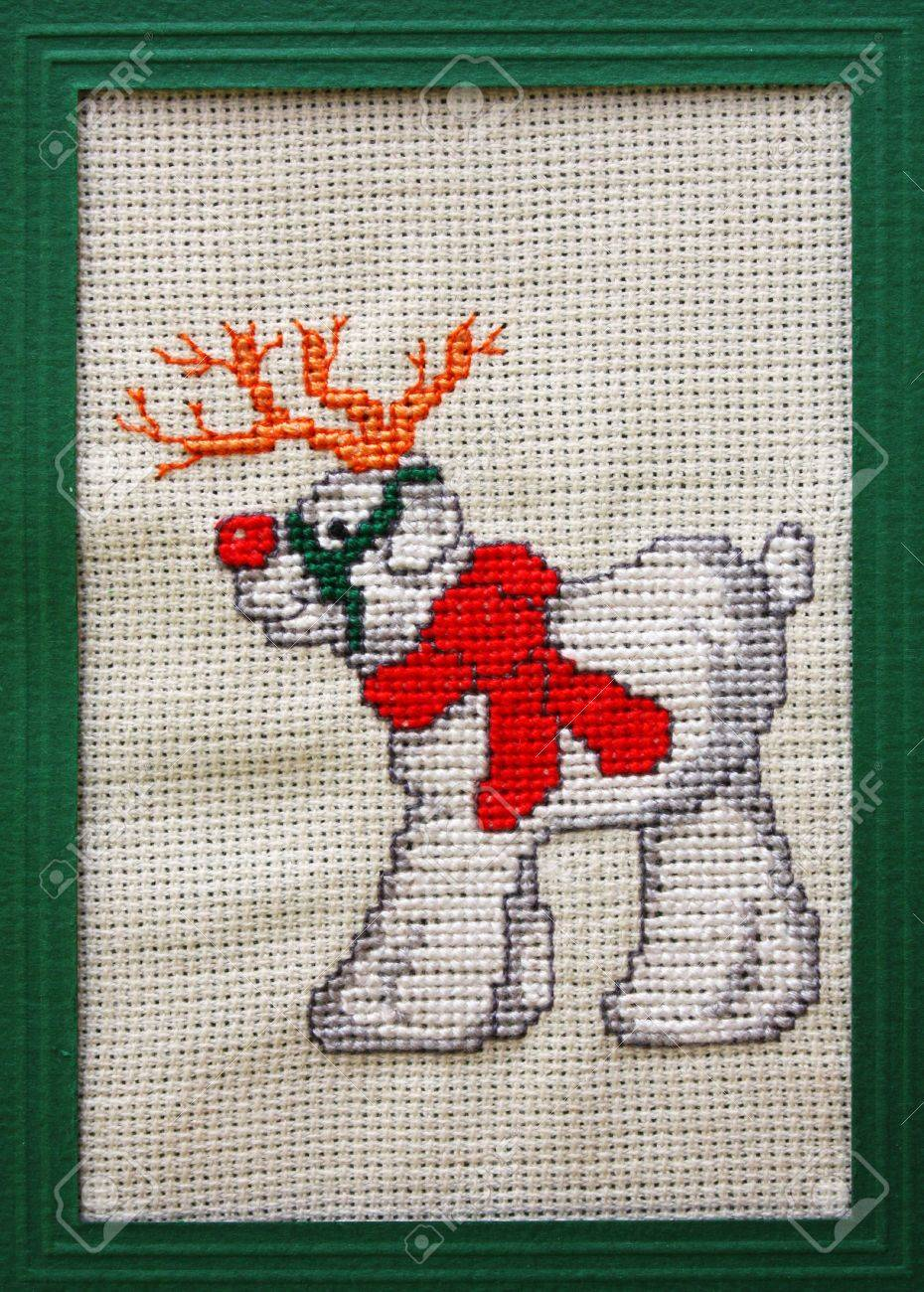 Cross Stitch Christmas Card Showing A Red Nose Reindeer Stock Photo