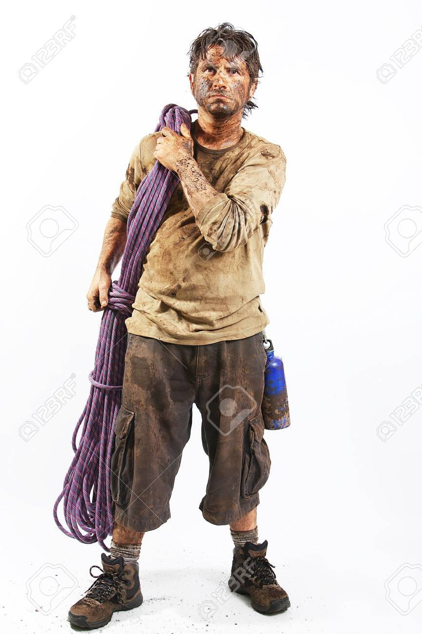 A man covered in mud with a rope, trying to survive Stock Photo - 16640837