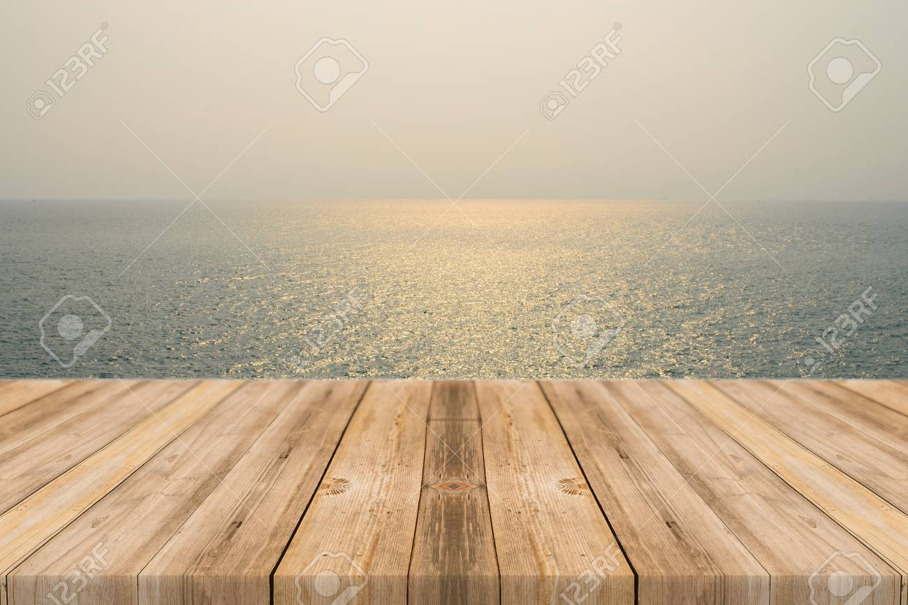 Vintage wooden board empty table in front of sea sky background. Perspective wood floor over sea and sky - can be used for display or montage your products. beach summer concepts. - 45069438