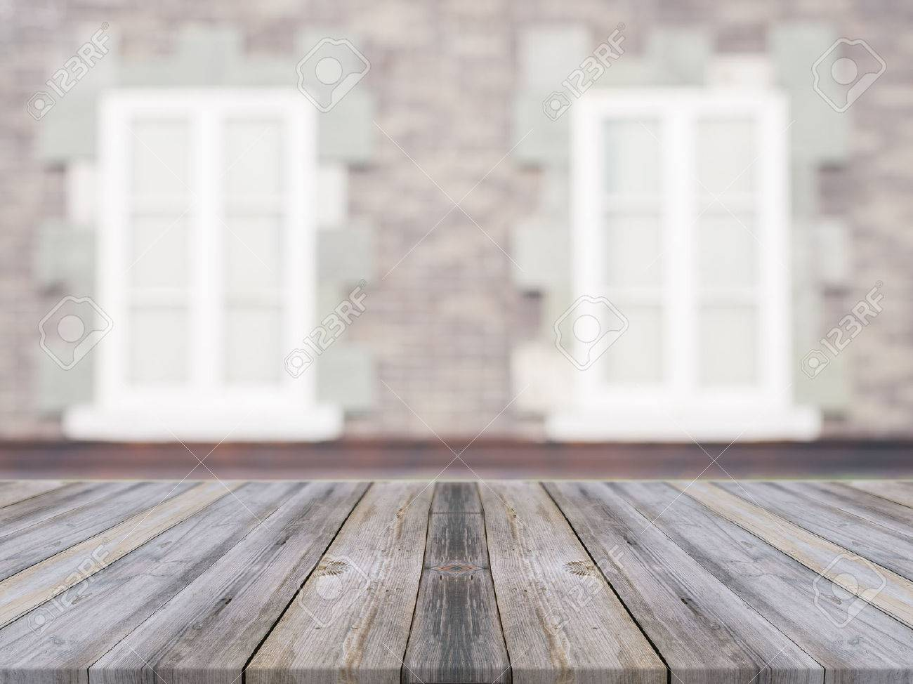 Wooden board empty table in front of blurred background wooden board empty table in front of blurred background perspective grey wood over blur ceramic dailygadgetfo Image collections