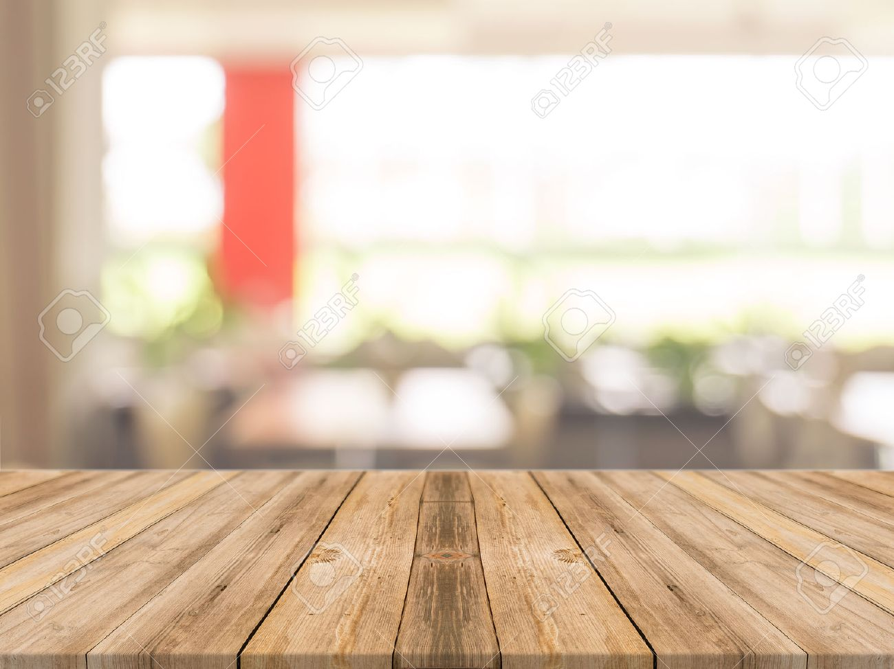 Empty wood table and blurred living room background stock photo - Wooden Board Empty Table In Front Of Blurred Background Perspective Brown Wood Over Blur In