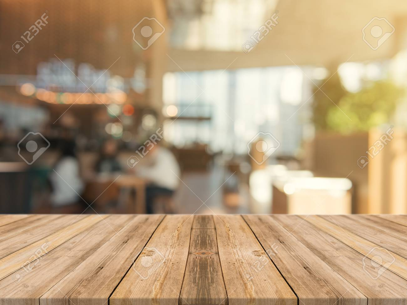 Wooden board empty table top on of blurred background. Perspective brown wood table over blur in coffee shop background - can be used mock up for montage products display or design key visual layout. - 88470651