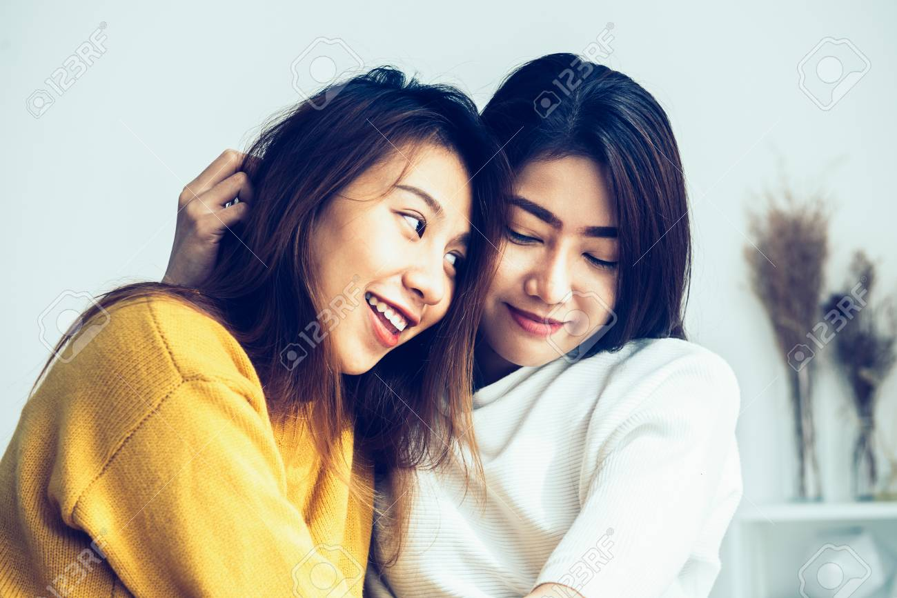Lesbian women together in bed