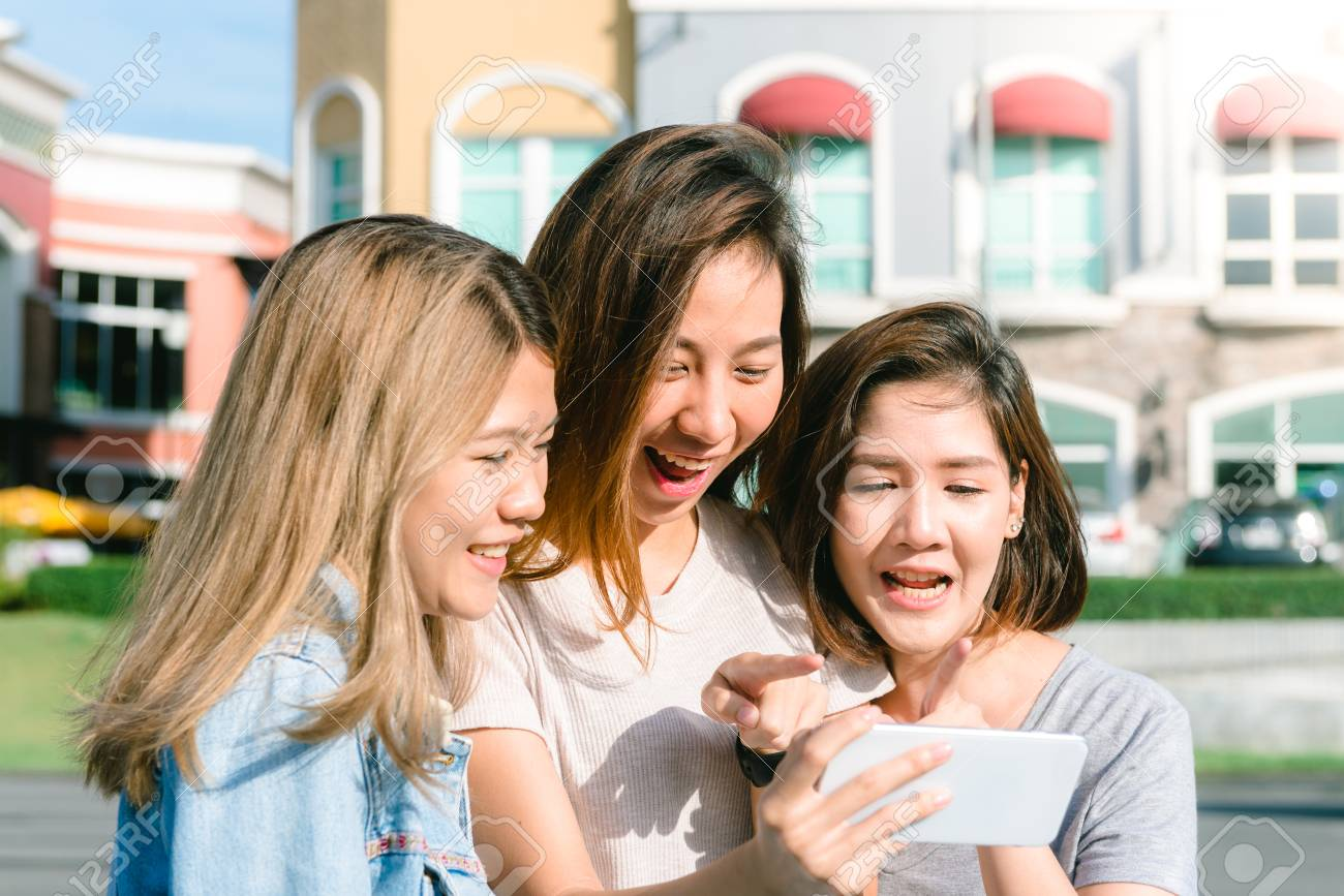 3249427a994 Group of young Asian Women selfie themselves with a phone in a pastel town  after shopping