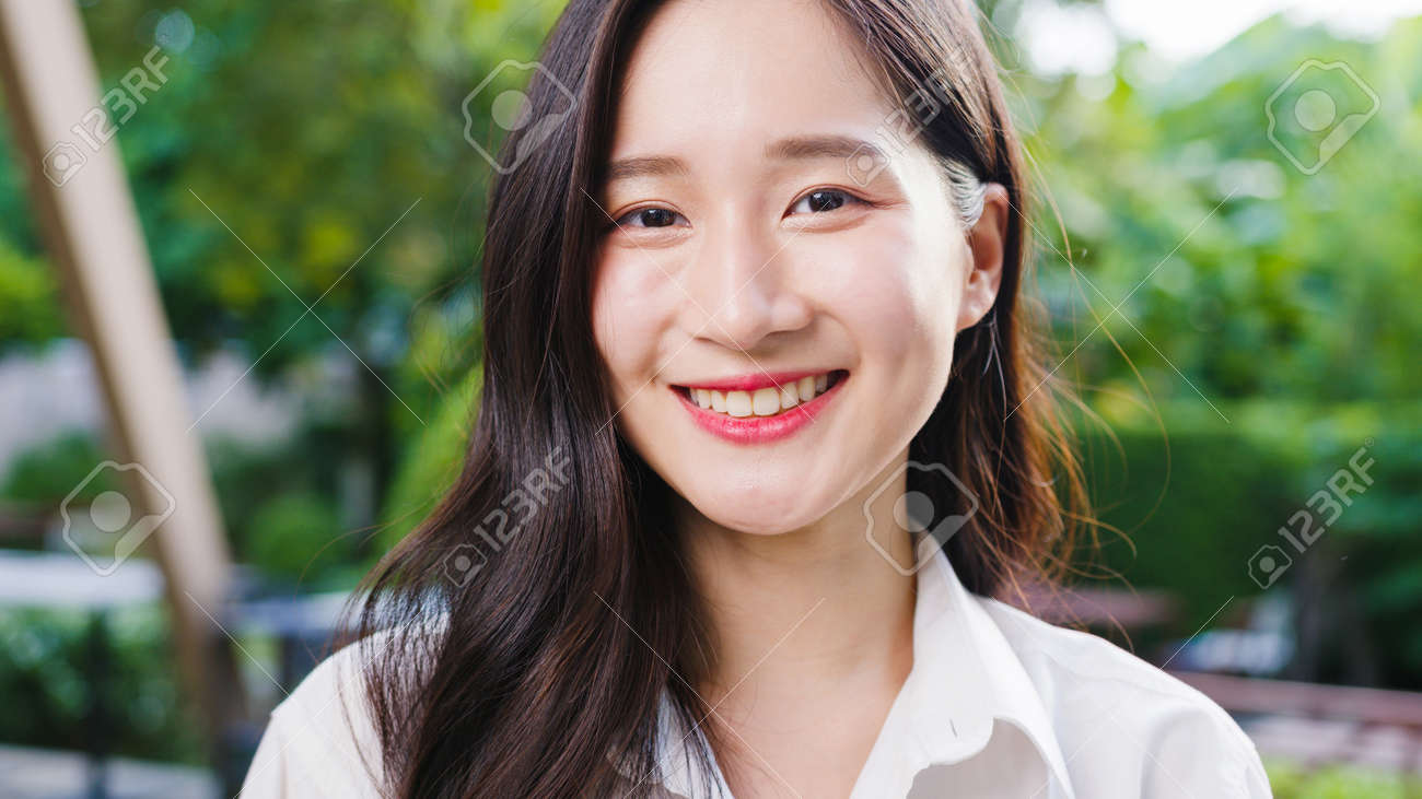 Happy young Asian female feeling happy smiling and looking to camera while relax on street in modern city. Lifestyle woman at outside house concept. - 171981311