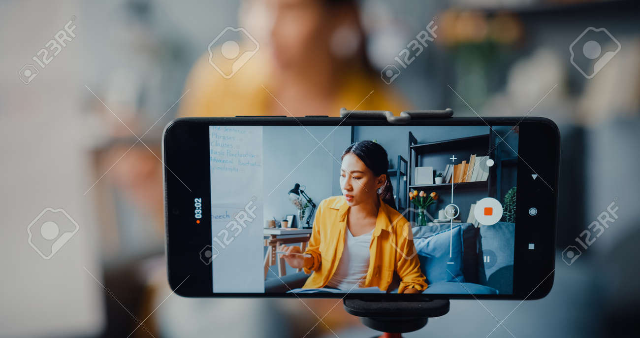 Young Asia lady english teacher video call on smartphone talk by webcam learn teach in online chat at home. Remote classroom, Social distance, quarantine for corona virus prevention. Close up screen. - 169422889