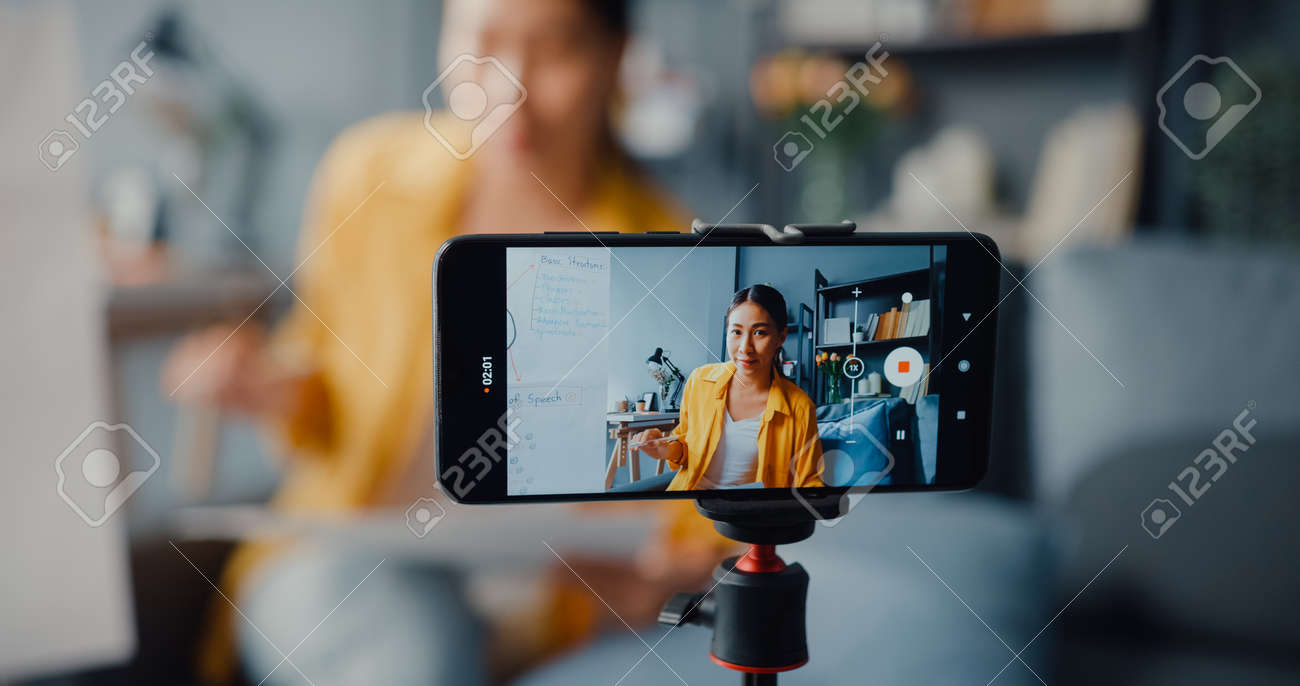 Young Asia lady english teacher video call on smartphone talk by webcam learn teach in online chat at home. Remote classroom, Social distance, quarantine for corona virus prevention. Close up screen. - 169422890