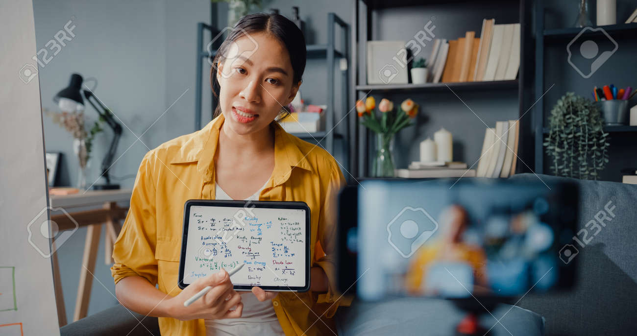 Young Asia lady teacher video conference calling on smartphone talk by webcam learn teach in online chat at home. Remote school classroom, Social distancing, quarantine for corona virus prevention. - 169422894
