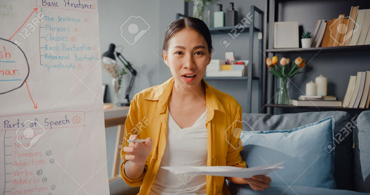 Young Asia lady english teacher video conference looking at camera talk by webcam learn teach in online chat at home. Remote classroom, Social distancing, quarantine for corona virus prevention. - 169422978