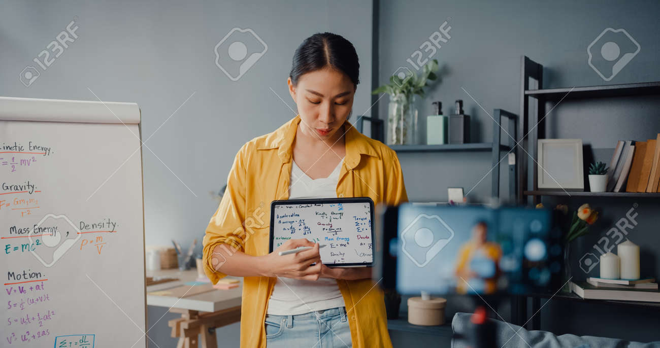 Young Asia lady teacher video conference calling on smartphone talk by webcam learn teach in online chat at home. Remote school classroom, Social distancing, quarantine for corona virus prevention. - 169422979
