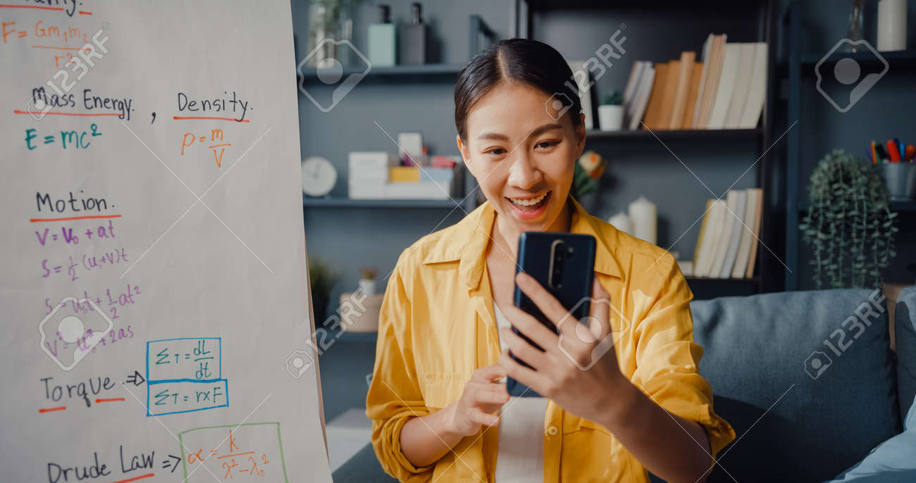 Young Asia lady teacher video conference calling on smartphone talk by webcam learn teach in online chat at home. Remote school classroom, Social distancing, quarantine for corona virus prevention. - 169422981