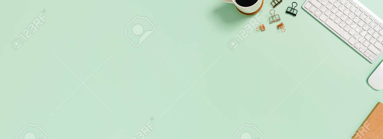 Creative flat lay photo of workspace desk. Top view office desk with keyboard and mouse on pastel green color background. Panoramic banner with copy space for text and Advertising area. - 172013345
