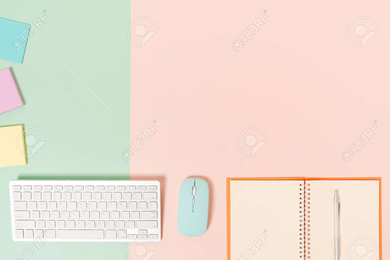 Creative flat lay photo of workspace desk. Top view office desk with keyboard, mouse and open mockup black notebook on pastel green pink color background. Top view mock up with copy space photography. - 172013395