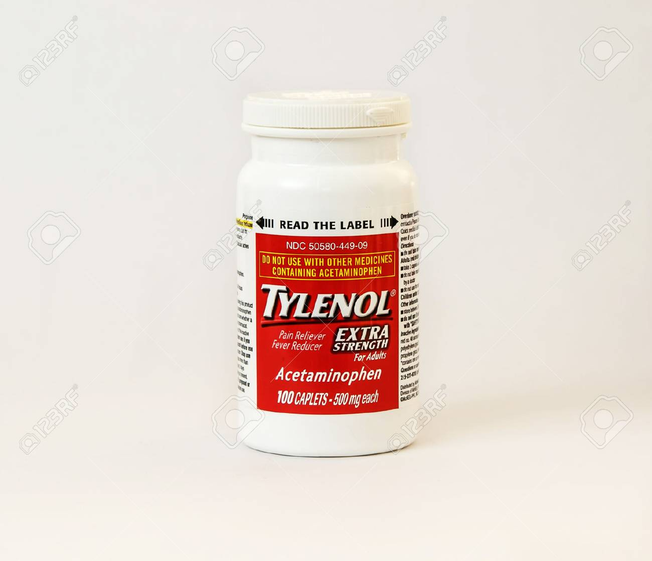 New York, December 02: A bottle of Tylenol pain reliever pills isolated on white. - 73837164