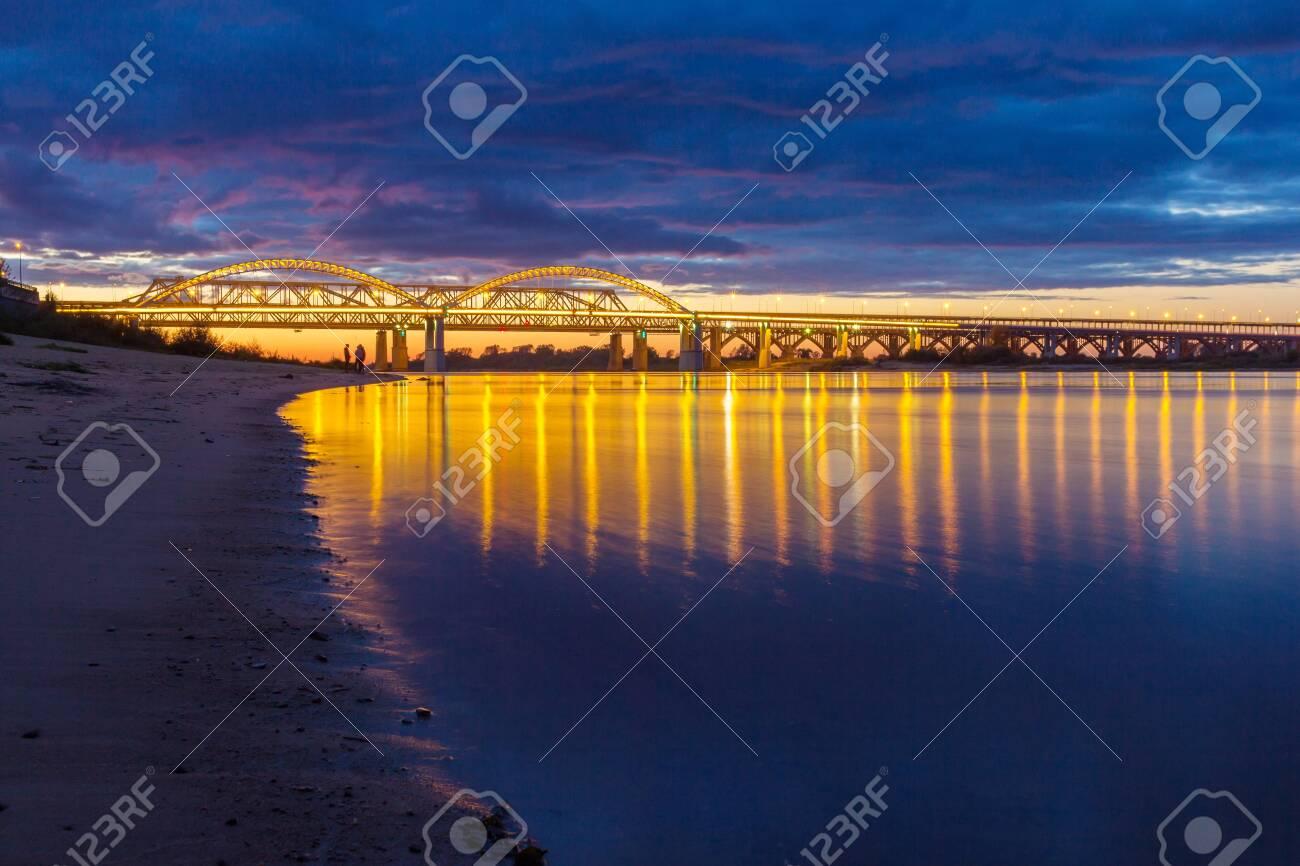 Bridge with reflection in the Volga river in Nizhny Novgorod, Russia - 142737667