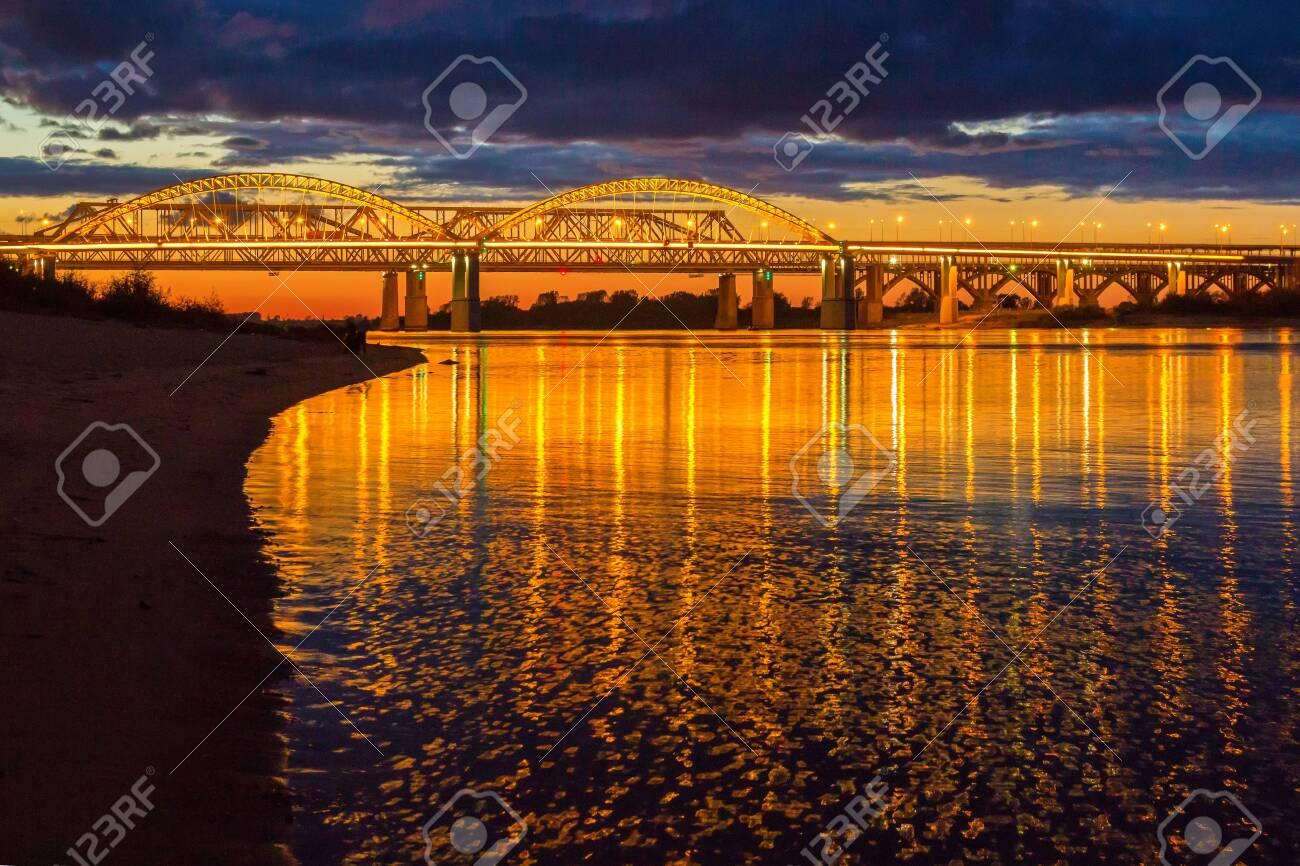 The bridge over the Volga River in Nizhny Novgorod in the evening illumination - 142550482