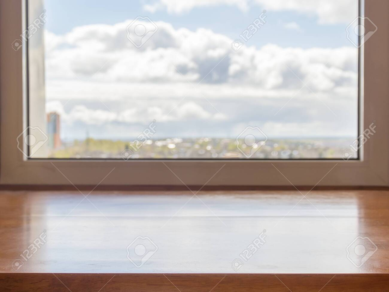 Window with a wooden window sill and landscape in it - 144232386
