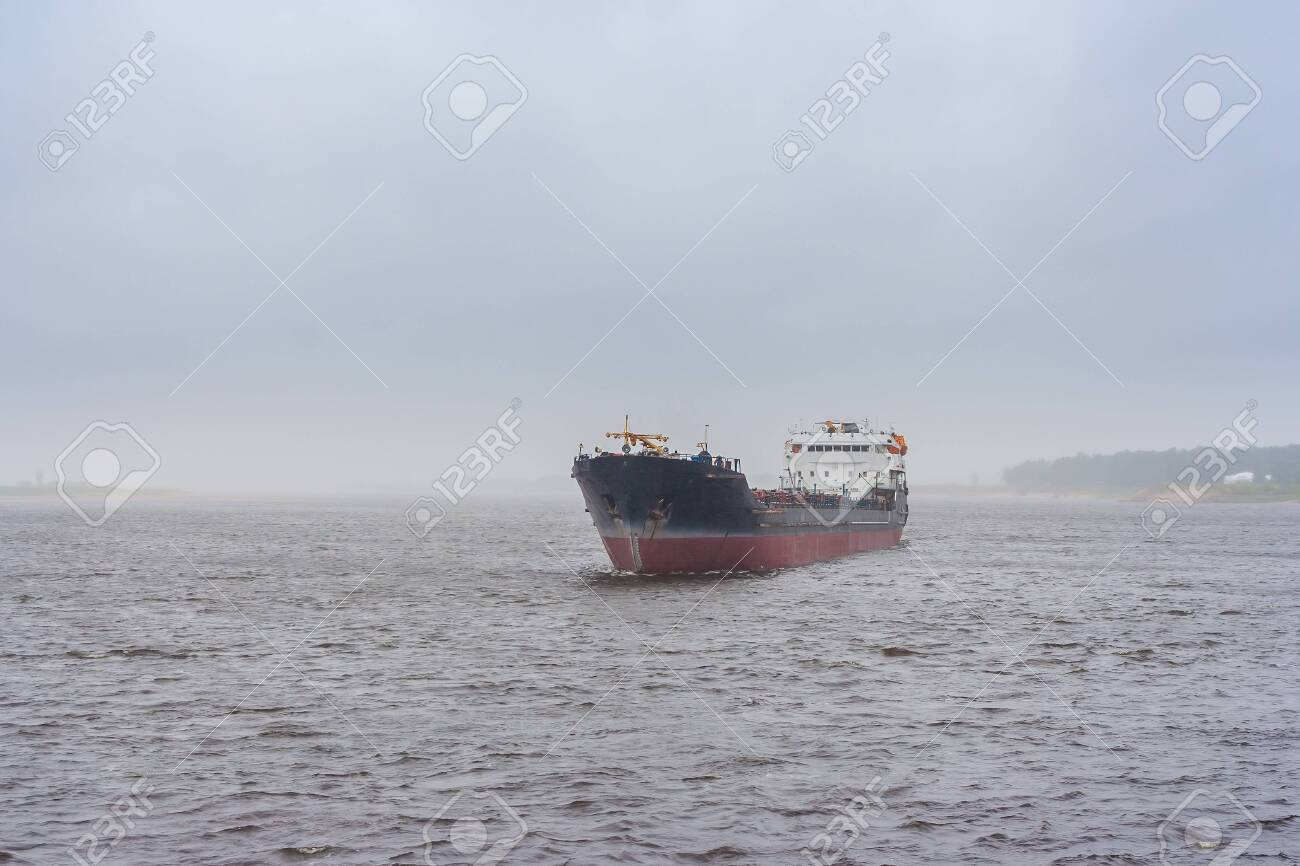 Cargo ship on the river in the fog - 144347375
