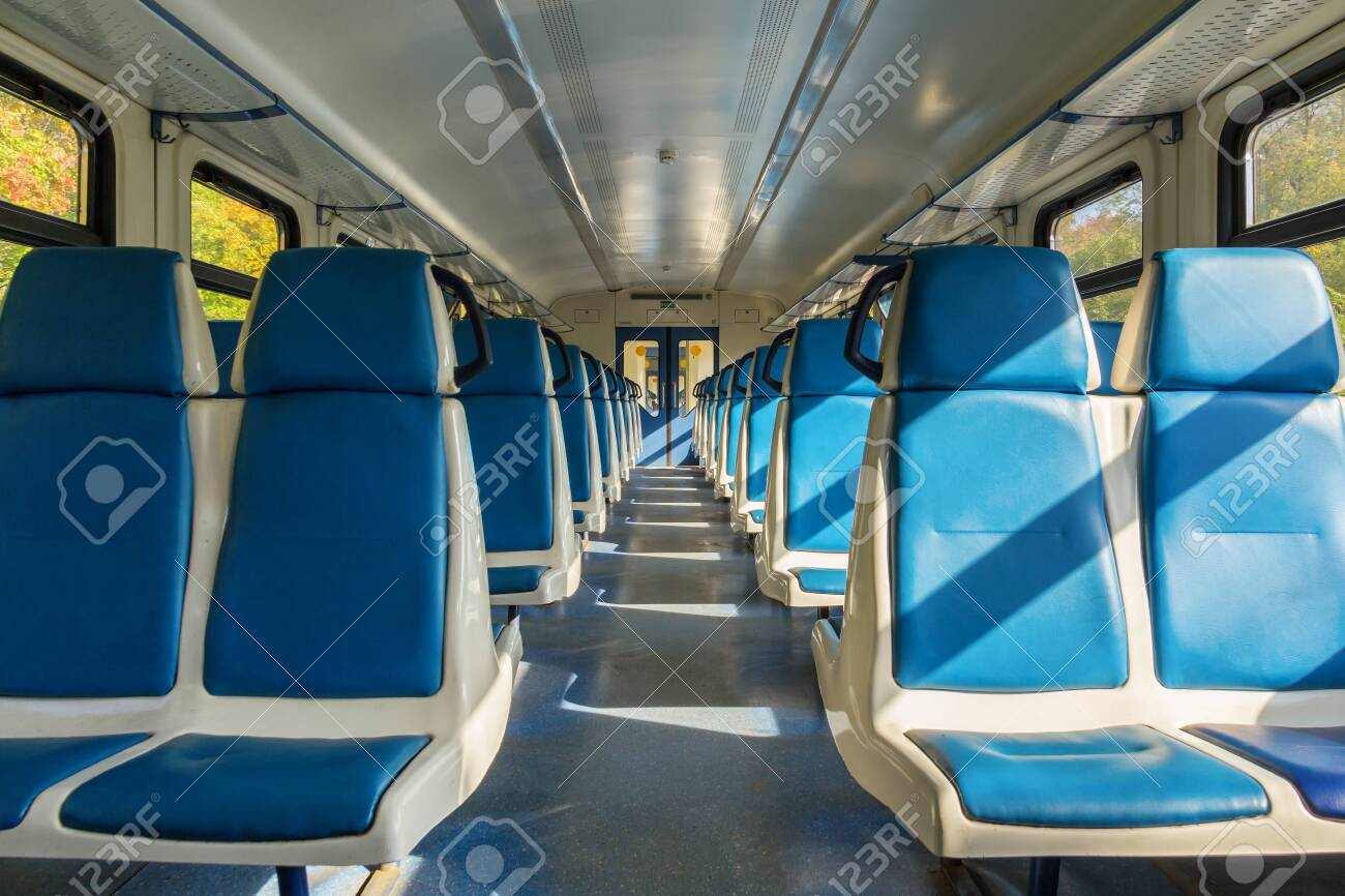 Blue seats in an electric train carriage without passengers in Russia - 144607420