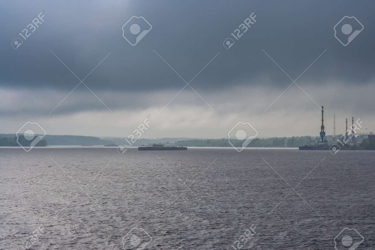 Rain and clouds over the river and the city at summer - 145773444